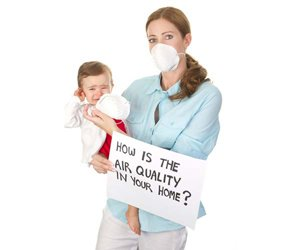 Woman and child wearing dust masks